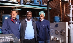 Sir Fruit Production Manager, Andreas Janse van Rensburg and NCPC-SA Project Manager Mashudu Madzivhandila and Sir Fruit Quality Assurance Officer, Thabang Masiu during a plant visit after the installation of the cooling system earlier this year.